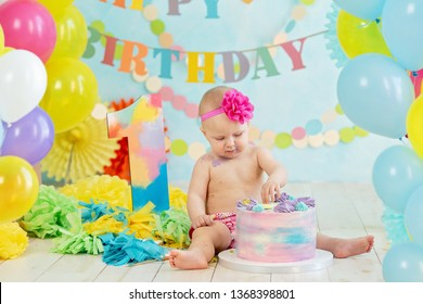 First birthday smash the cake. cream on legs. Festive background decoration for birthday with cake, Cake Smash first year concept. birthday greetings.