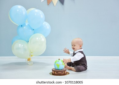 first birthday. smash the cake, a thematic birthday - a travel, trip. globe.