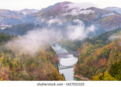 First bridge and Tadami river in beautiful autumn season.
