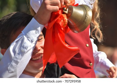 First call First-grader and graduate rings the bell in the School line September 1, 2017 Penza editorial