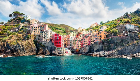 First city of the Cique Terre sequence of hill cities - Riomaggiore. Sunny morning view of Liguria, Italy, Europe. Splendid spring seascape of Mediterranean sea. Traveling concept background.