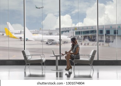First class business passenger sitting in luxury VIP exclusive lounge at airport, on laptop