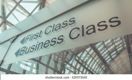 First Class and Business Class sign at the airport. (Vintage Style)