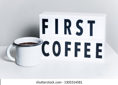 First Coffee text in lightbox with enamel cup