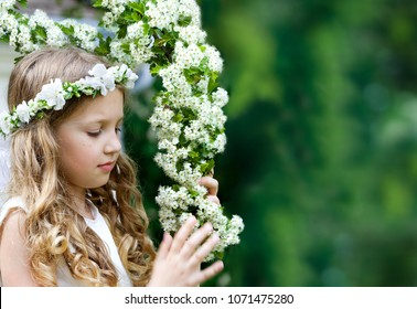 First Communion beautiful girl on green background