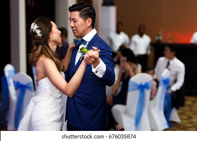 First dance of an attractive Asian couple