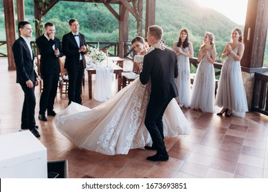 The first dance of the young. The bride and groom are dancing their first dance.