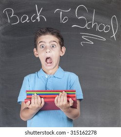 First day of school. Scared schoolboy in classroom.