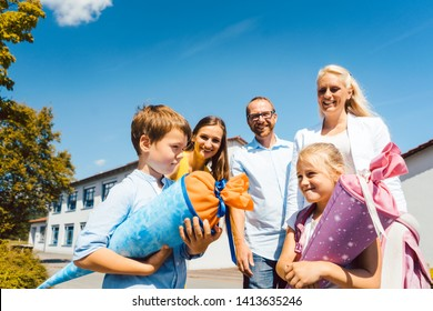 First day in school for two students being with the family carrying candy cones