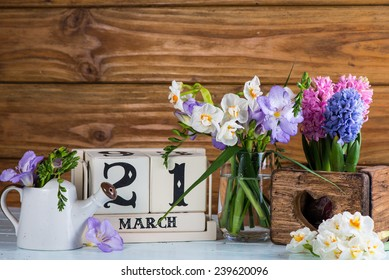 First day of spring vintage calendar and fresh flowers