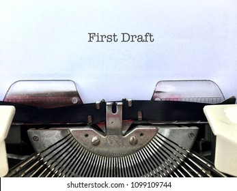 First Draft, author's manuscript title heading typed on white paper on vintage manual typewriter machine