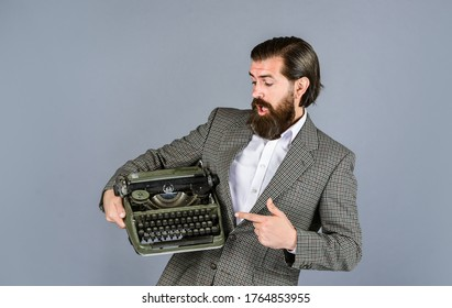first draft. professional typist make notes typing. modern and old technology. digital business. successful businessman use retro typewriter. mature man hold vintage device