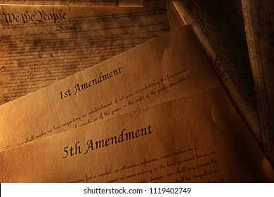 The First and Fifth Amendments and pages of the US Constitution
