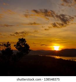 first golden sunrise in thailand.