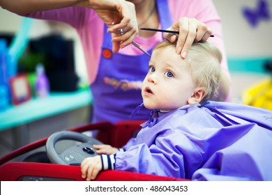 First haircut of little baby boy