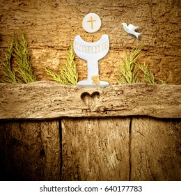 First Holy Communion background,Chalice and dove on rustic wooden background