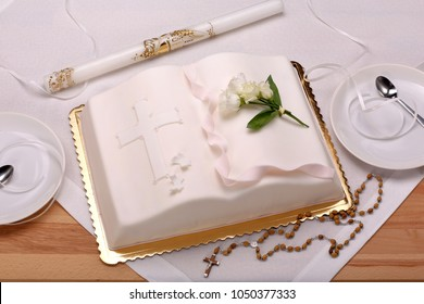 First holy communion cake on wooden background and space for text