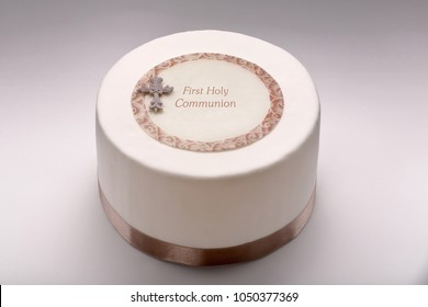 First holy communion cake on white background and space for text