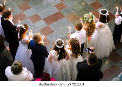 First holy communion in church, many little children