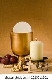 First Holy Communion composition on beige sackcloth background.
