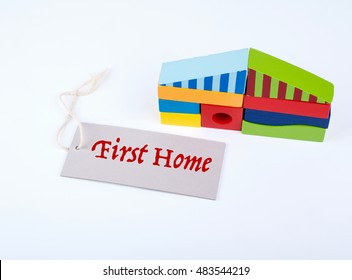First home. Colorful wooden game blocks on a white background