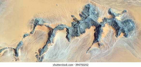 the first human skeletons,allegory, tribute to Pollock, abstract photography of the deserts of Africa from the air,aerial view, abstract expressionism, contemporary photographic art, abstract naturali