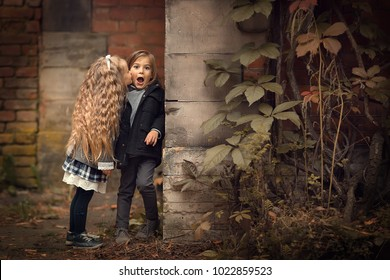 First kiss. Beautiful long-haired blonde girl is kissing a boy, who looks like very surprised. Image with selective focus and toning.