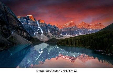 First light of dawn at Moraine Lake with golden sunrise over the Valley of the Ten Peaks in the Canadian Rockies of Banff National Park.
