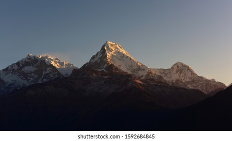 First light of the day hitting Annapurna & Annapurna South as viewed from Poon Hill summit in Nepal