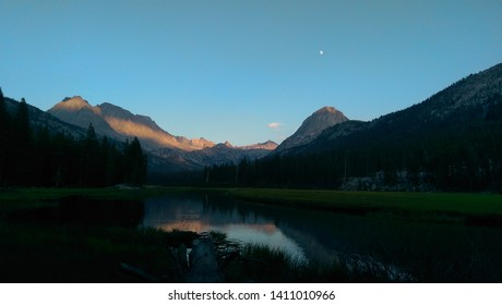 First light on the mountains in evolution valley on the john muir trail in the sierra nevada mountains.