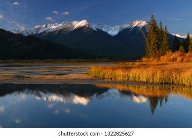 First light on Sundance Range at First Vermilion Lake in the Fall