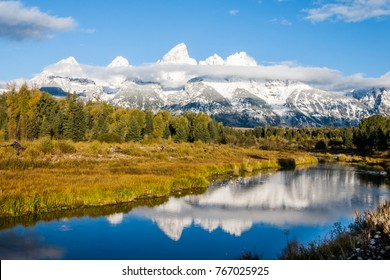 First light on the Teton Range in Grand Teton National Park in Wyoming in Autumn.