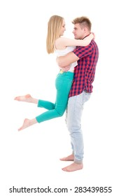 first love concept - young man holding her girlfriend isolated on white background