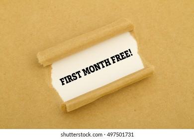"""First month free"" written under torn paper."