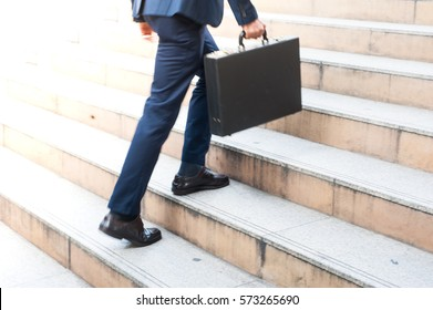 First Morning of Work Businessman hold bag Walking up the Stairs in a Rush Hour to work. Hurry Time . Working  Business man