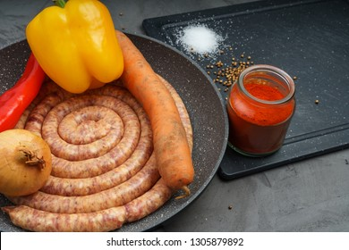 First page menu, pork sausage with ingredients, raw food on dark desk