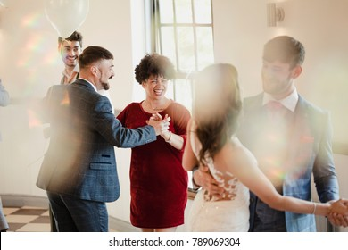 First partner dance at a wedding. All of the couples are dancing together along with the bride and groom.