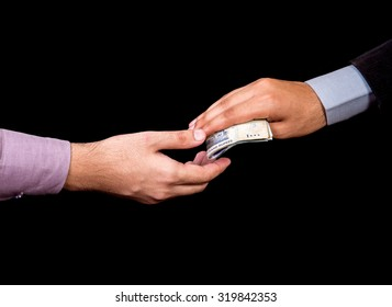 first person is giving 1000 Rupees Pakistani Currency Notes to another Person isolated with black background