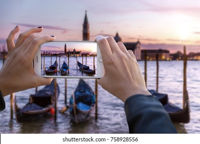 First person perspective point of view hands holding smartphone capturing footage of holiday travels in europe