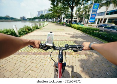 First person view of cycling riding bike in the city