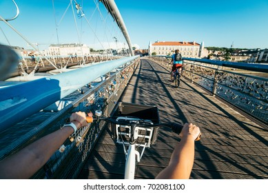 first person view ride on bicycle cross the river in the evening
