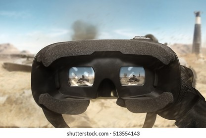 First person view soldier arm using vr glasses. First person view soldier hand in black battle gloves & tactical jacket using vr glasses on desert tank war scene with health & armor indicator.