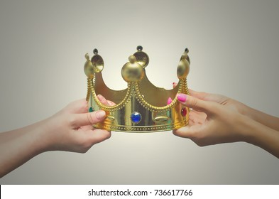 First place competition concept. Struggle for power. Race for power. Supremacy struggle. Two person pull golden crown at each other. Struggle for love between two woman.