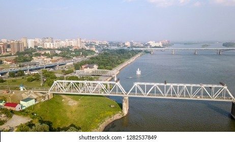 First Railway Bridge in Novosibirsk. Panorama of the city of Novosibirsk. View on the river Ob. Russia, From Dron