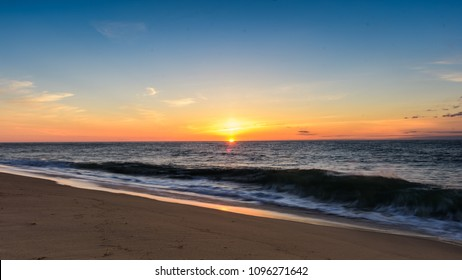 First rays of the morning Sunrise on the Beach