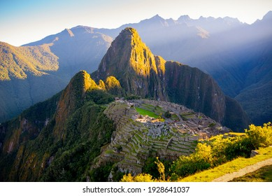 The first rays of the sun on Machu Picchu , the lost city of inca - Peru