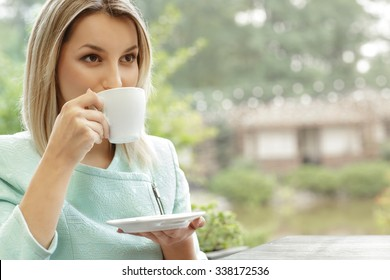 First sip. Portrait of a young woman drinking her morning coffee over a breakfast in the cafe