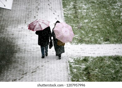 the first snow in the city. people with umbrella, view from above - Shutterstock ID 1207957996