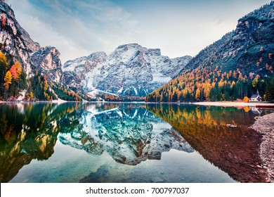 First snow on Braies Lake. Colorful autumn landscape in Italian Alps, Naturpark Fanes-Sennes-Prags, Dolomite, Italy, Europe. Beauty of nature concept background.