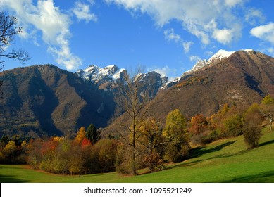 The first snow on the mountains and the woods still with the autumn colors